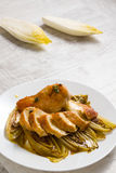 Fried chicken and chicory in sauce Stock Photography