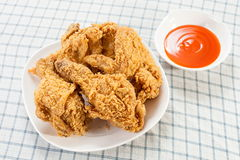 Fried chicken with chili sauce Royalty Free Stock Photo