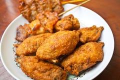 Fried Chicken con cerdo asado a la parrilla Imagenes de archivo