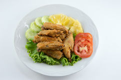 Fried chicken. Fried crispy chicken with vegetables Royalty Free Stock Photos