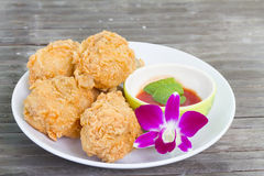 Fried chicken and decorative orchid Stock Photos