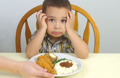 Fried Chicken Dinner. A young boy ready to eat his supper stock image