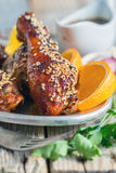 Fried chicken drumsticks with sesame seeds close-up. Stock Photo