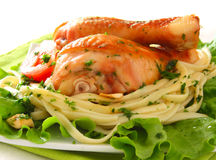 Fried chicken drumsticks with spaghetti Stock Images