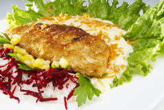 Fried chicken fillet. Fried chicken with garnish smashed potatoes,lettuce,corn, beet Royalty Free Stock Photo