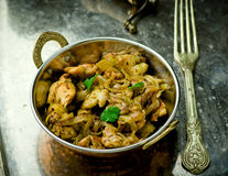 Fried chicken fillet in the Indian copper bowl Royalty Free Stock Images