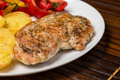 Fried chicken fillet with potato and vegetables Royalty Free Stock Image
