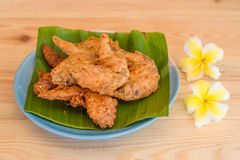 Fried chicken(food). Fried chicken on banana leaf Stock Images
