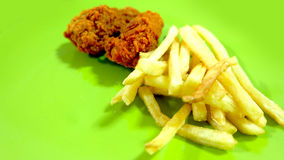 Fried Chicken and French Fries on Green Background Royalty Free Stock Photos