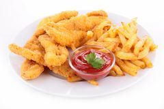 Fried chicken and french fries Stock Images