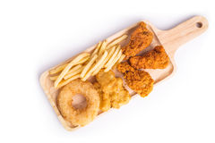 Fried chicken, french fries and soft drink on wooden table Stock Images
