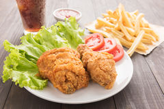 Fried chicken and french fries on a wooden background Royalty Free Stock Photos
