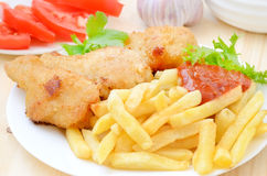 Fried chicken with french fries Stock Photos
