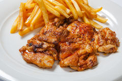 Fried chicken with fries on white plate.  stock photo