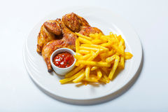 Fried chicken with fries on white plate Royalty Free Stock Image
