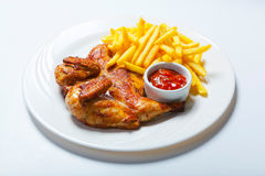 Fried chicken with fries on white plate Royalty Free Stock Photos