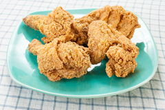 Fried chicken on green dish Royalty Free Stock Photos