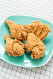 Fried chicken on green dish Royalty Free Stock Images