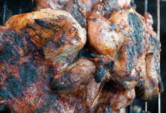 Fried chicken on the grill. Roast chicken leg on grill Royalty Free Stock Images