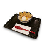 Fried chicken and hard-boiled egg topping on rice as background.  Royalty Free Stock Photography