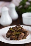 Fried chicken hearts with green beans Royalty Free Stock Images