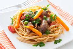 Fried chicken hearts , pasta and vegetables Royalty Free Stock Photos