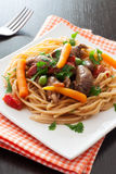 Fried chicken hearts , pasta and vegetables Stock Photo