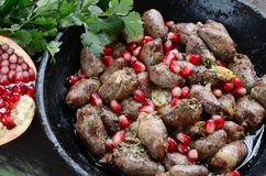 Fried chicken hearts with pomegranate in Georgian style Royalty Free Stock Image