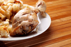 Fried chicken leg. And Potato on a Dish Royalty Free Stock Photos