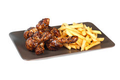 Fried chicken leg with french fries Stock Images