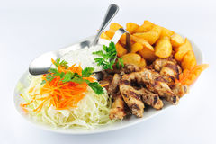 Fried chicken leg with boiled fries Royalty Free Stock Photography