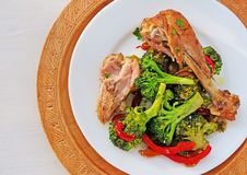 Fried chicken leg with fusilli pasta, broccoli and vegetables stock images