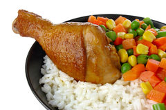 Fried chicken leg with rice and vegetables Royalty Free Stock Photos