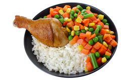 Fried chicken leg with rice and vegetables Stock Images