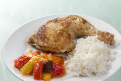 Fried chicken leg with rice and vegetables Royalty Free Stock Image