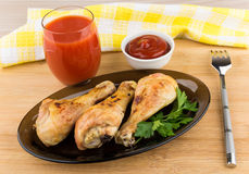 Fried chicken legs in dish, tomato juice and sauce Royalty Free Stock Photo