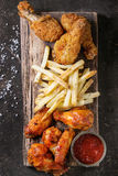 Fried chicken legs with french fries Royalty Free Stock Image