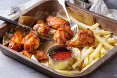 Fried chicken legs with french fries Royalty Free Stock Photography
