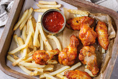 Fried chicken legs with french fries Royalty Free Stock Photo