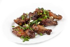 Fried chicken legs with green onions Stock Photos