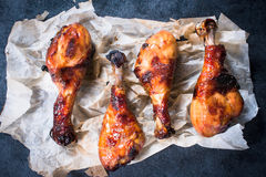 Fried chicken legs on paper Royalty Free Stock Photos