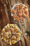 Fried Lemon Chicken Legs With Oven Baked Potato And Serbian Gibanica Cheese Pie Set On Old Weathered Garden Table Grunge Surface Royalty Free Stock Photos