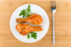 Fried chicken legs with tomato sauce and parsley in plate Royalty Free Stock Images