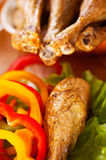 Fried chicken legs with vegetables Royalty Free Stock Image