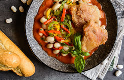 Fried chicken legs with white bean, vegetable and tomato sauce. Fried chicken legs with white bean, tricolor bell pepper and tomato sauce royalty free stock photos