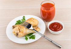 Fried chicken legs in white plate, tomato juice and sauce Stock Photography