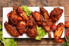 Fried chicken legs and wings royalty free stock image