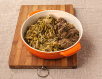 Fried chicken liver and garnish green green beans with onion Royalty Free Stock Photo