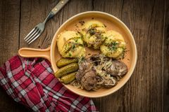 Fried chicken liver with onion served with mashed potatoes and p Stock Images