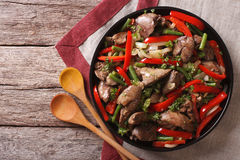 Fried chicken liver  with vegetables on a dish. horizontal top v Royalty Free Stock Image